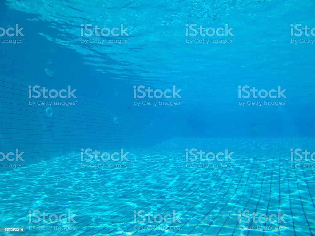 swimming pool underwater stock photo