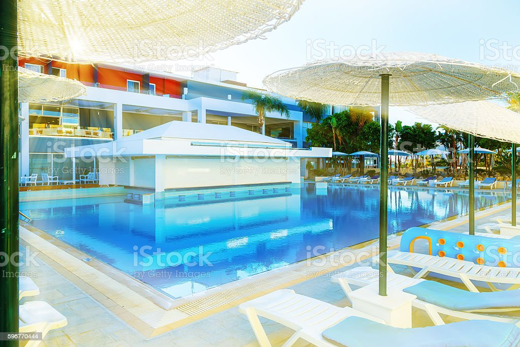 Swimming pool with bar at a luxury tropical hotel resort stock photo