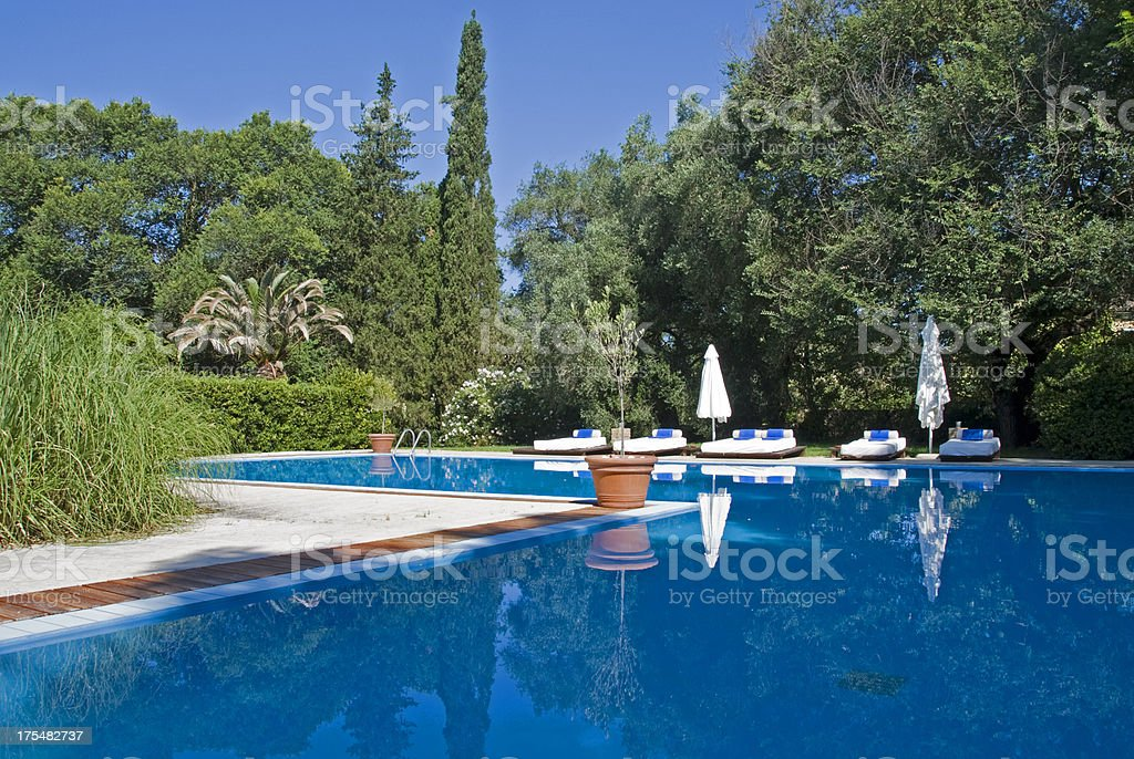 Swimming Pool with beds royalty-free stock photo