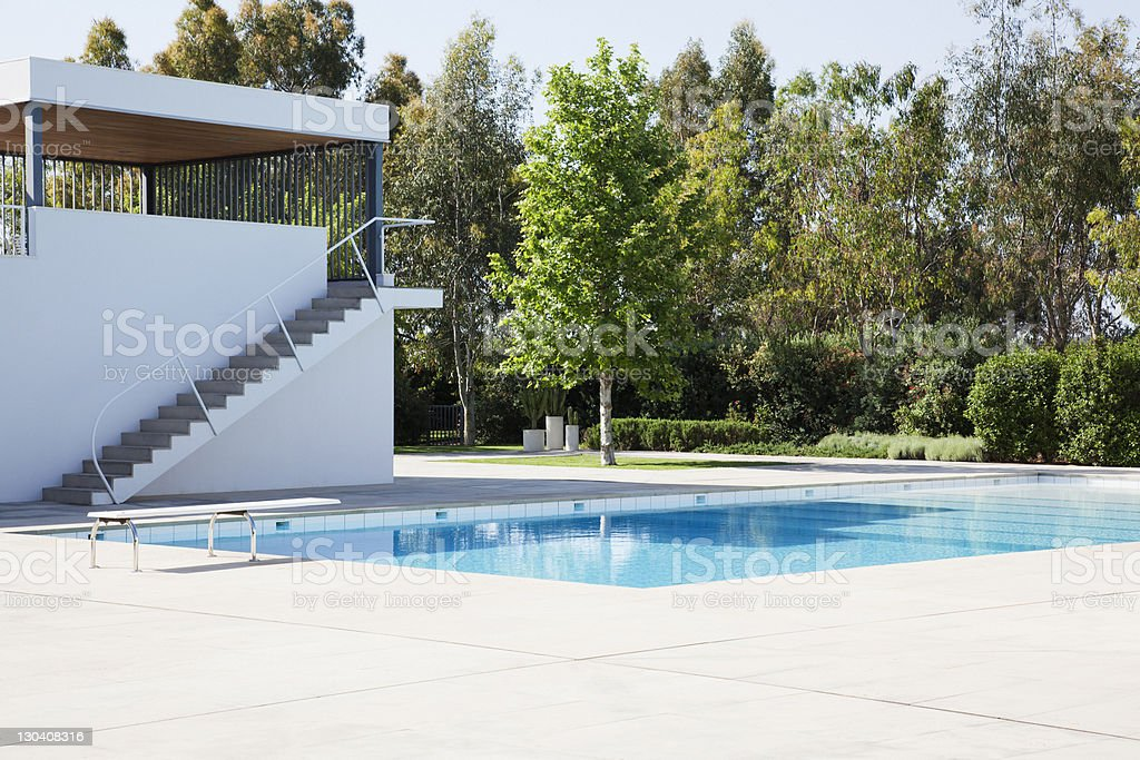 Swimming pool with diving board royalty-free stock photo