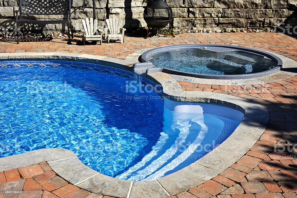 Swimming pool with hot tub stock photo