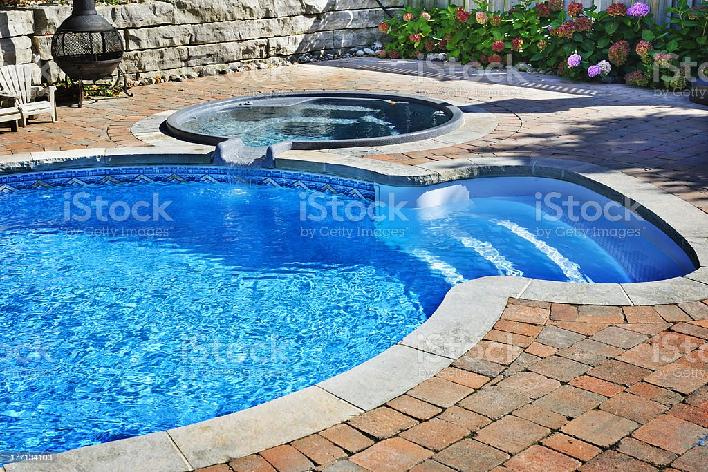 Swimming pool with hot tub royalty-free stock photo
