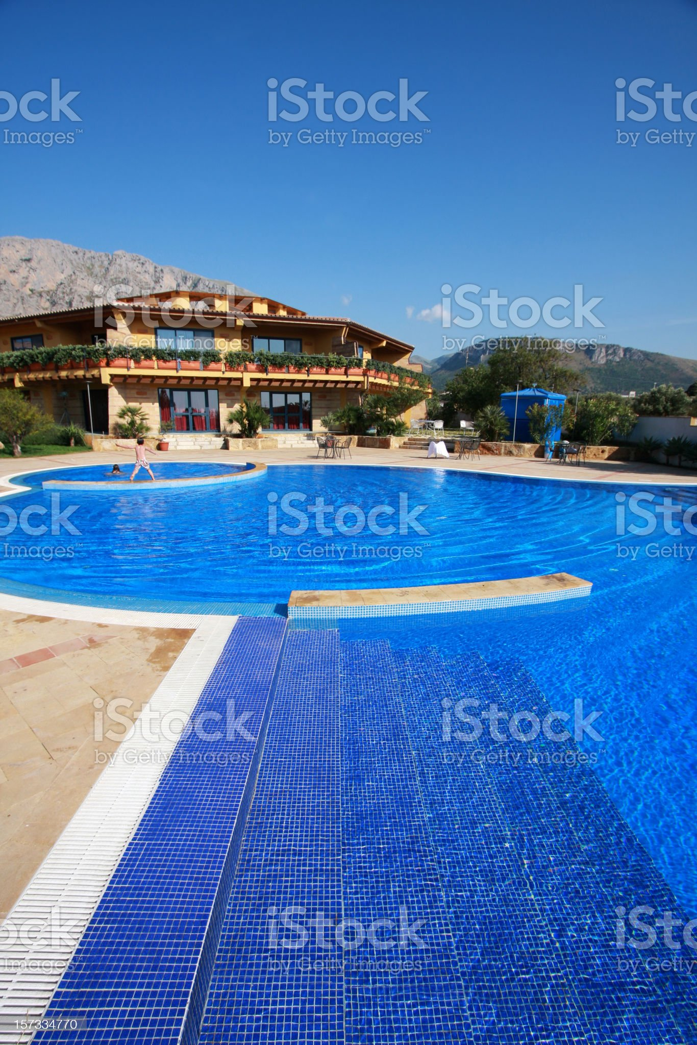 Swimming pool with luxury villa royalty-free stock photo