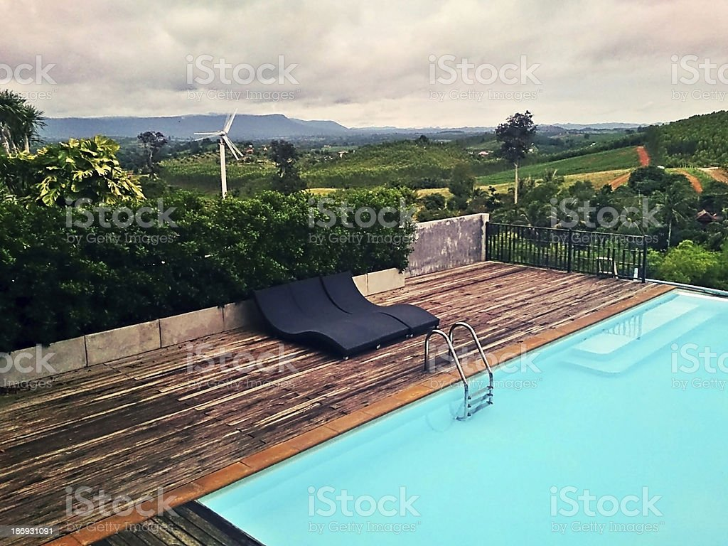 Swimming Pool With Mountain View royalty-free stock photo