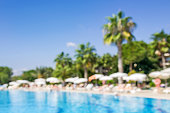 Swimming pool with palm trees.Abstract blurred background