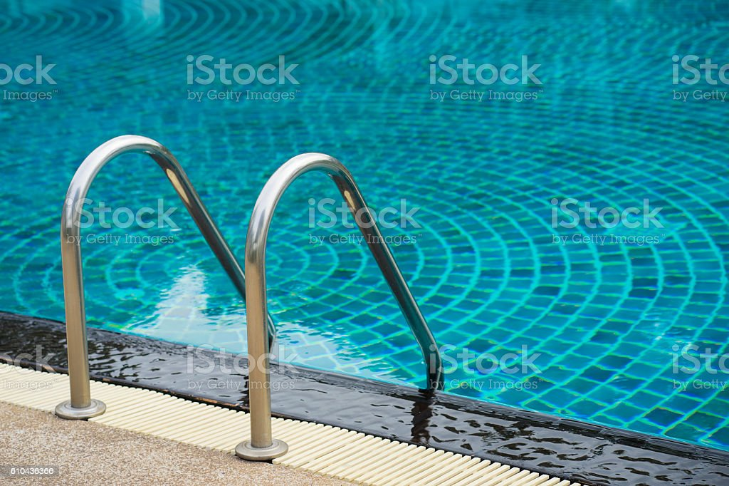 Swimming pool with stair at hotel stock photo