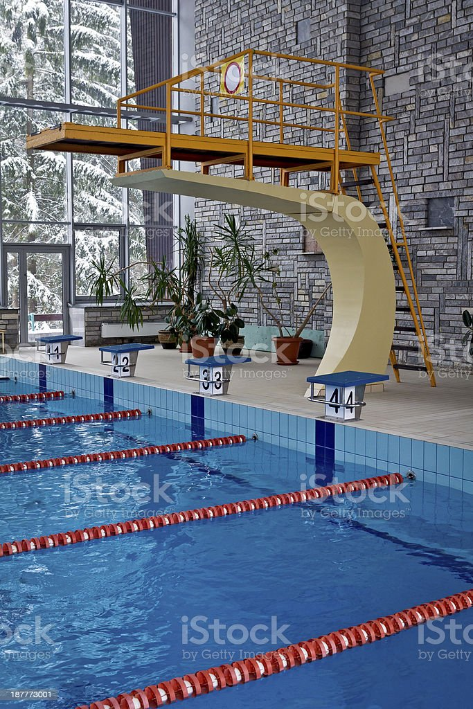 Swimming pool with stairs and tower royalty-free stock photo