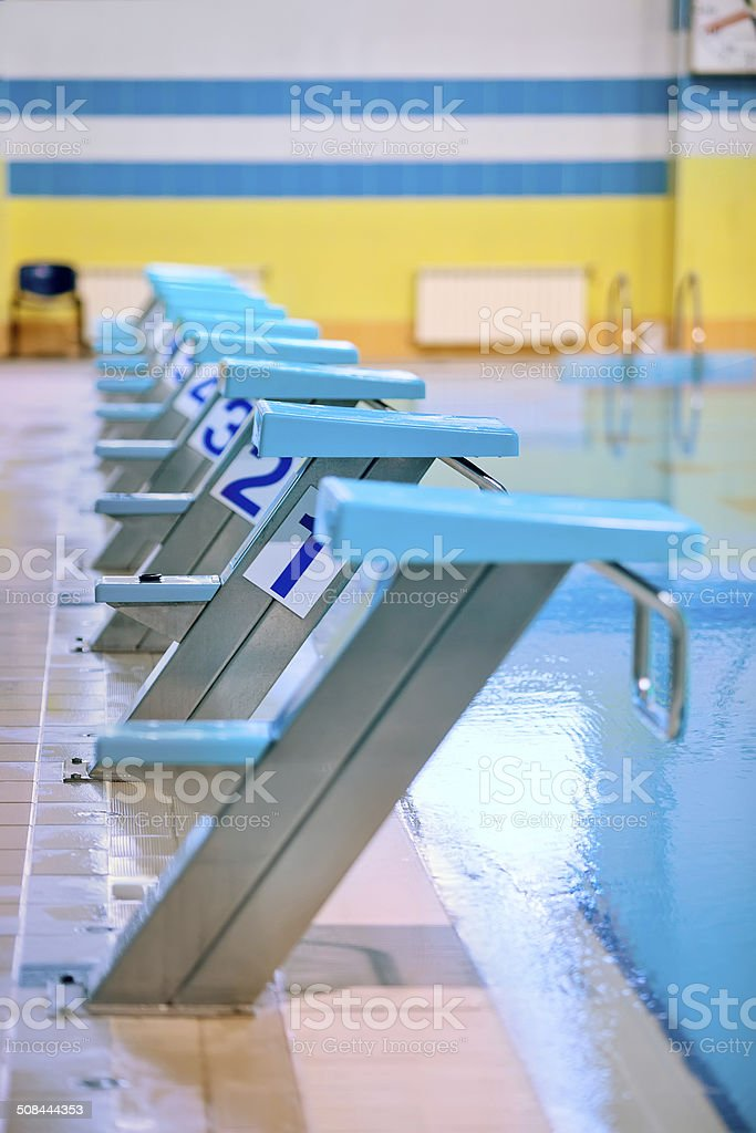 Swimming pool with starting blocks stock photo
