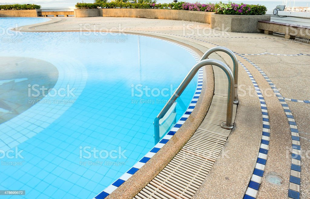 Swimming pool with steel ladder stock photo