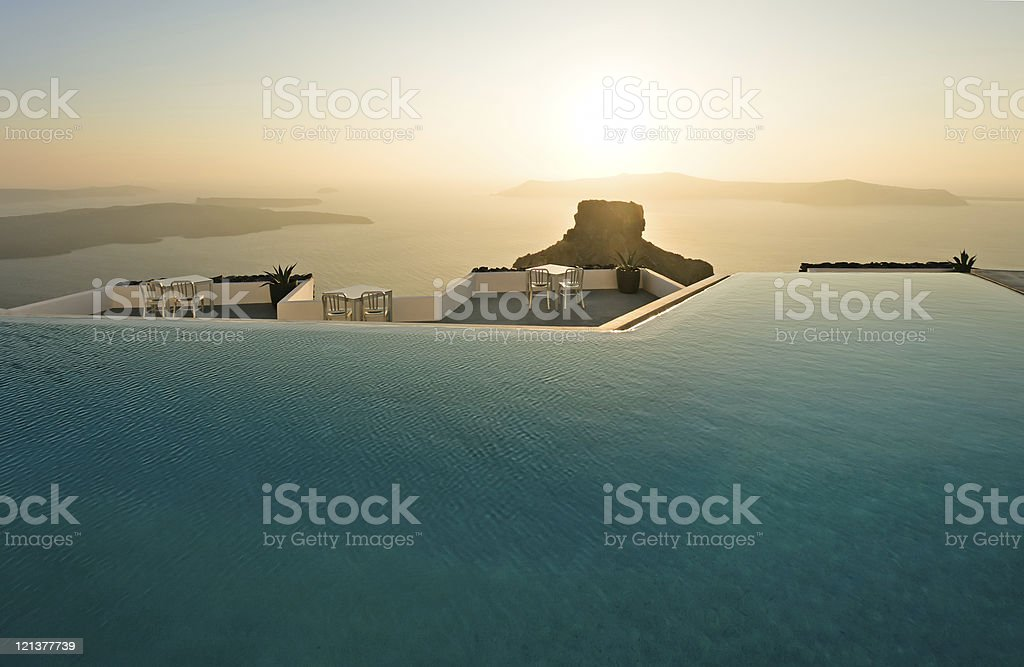 Swimming pool with sunset, Santorini, Greece royalty-free stock photo