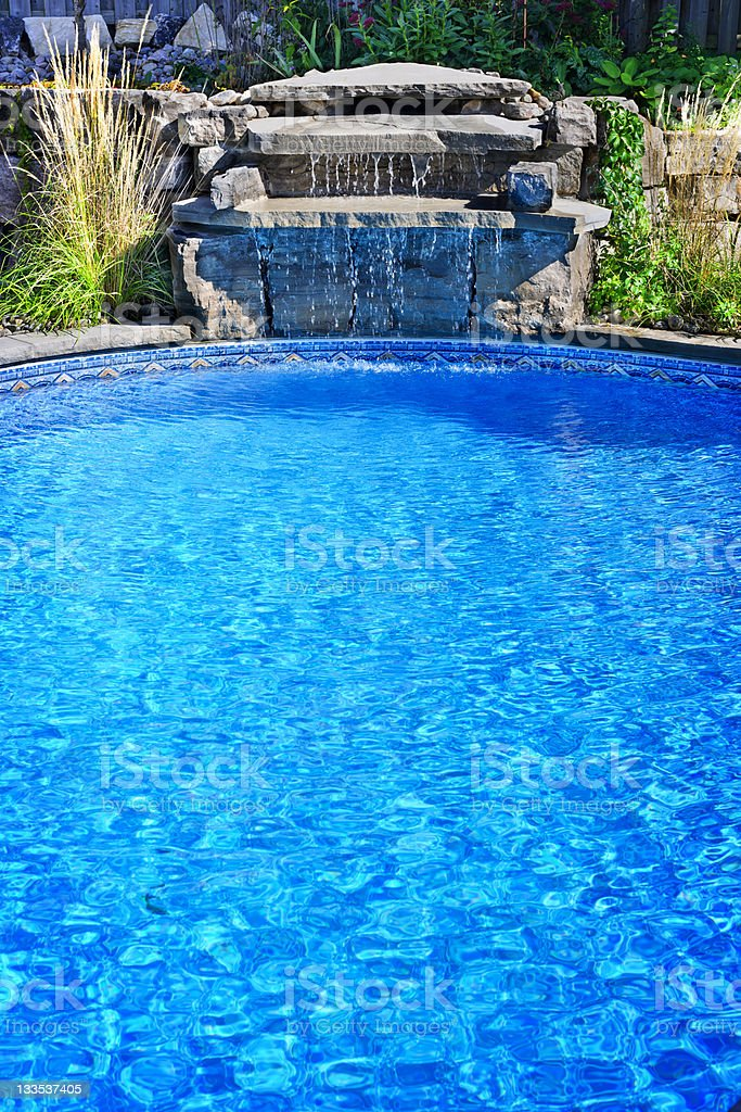 Swimming pool with waterfall stock photo
