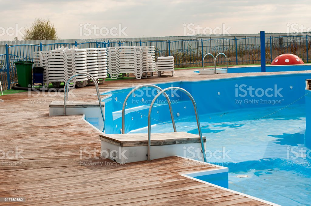 swimming pool with wooden walkway and springboar stock photo