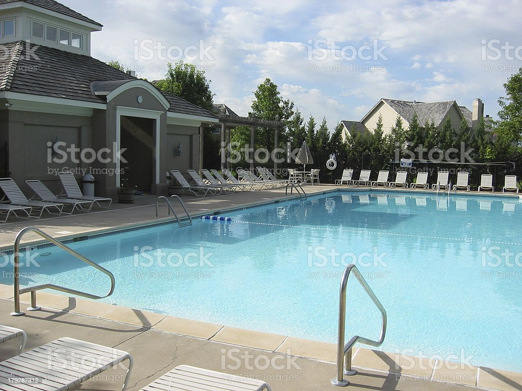 Swimming: Pristine Pool Refreshing Cool Water Blue Sky Puffy Clouds stock photo