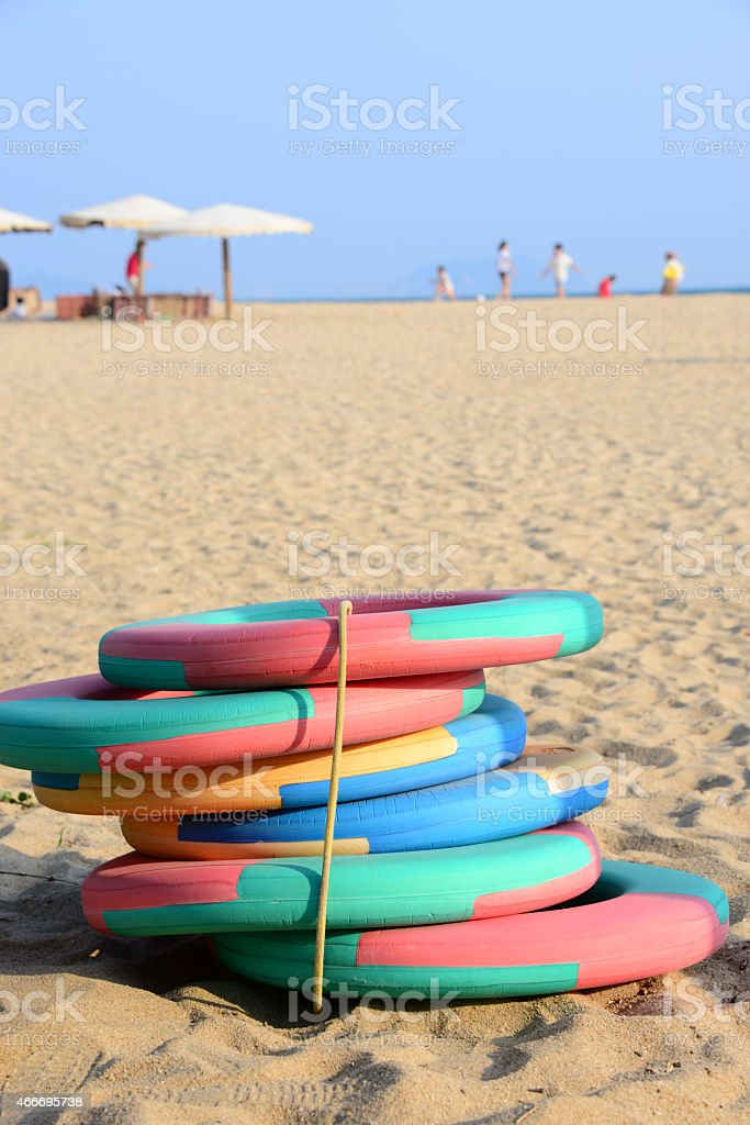 Swimming ring on the beach stock photo