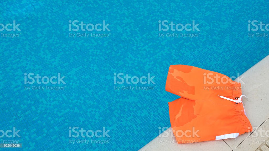 Swimming shorts beside the pool stock photo