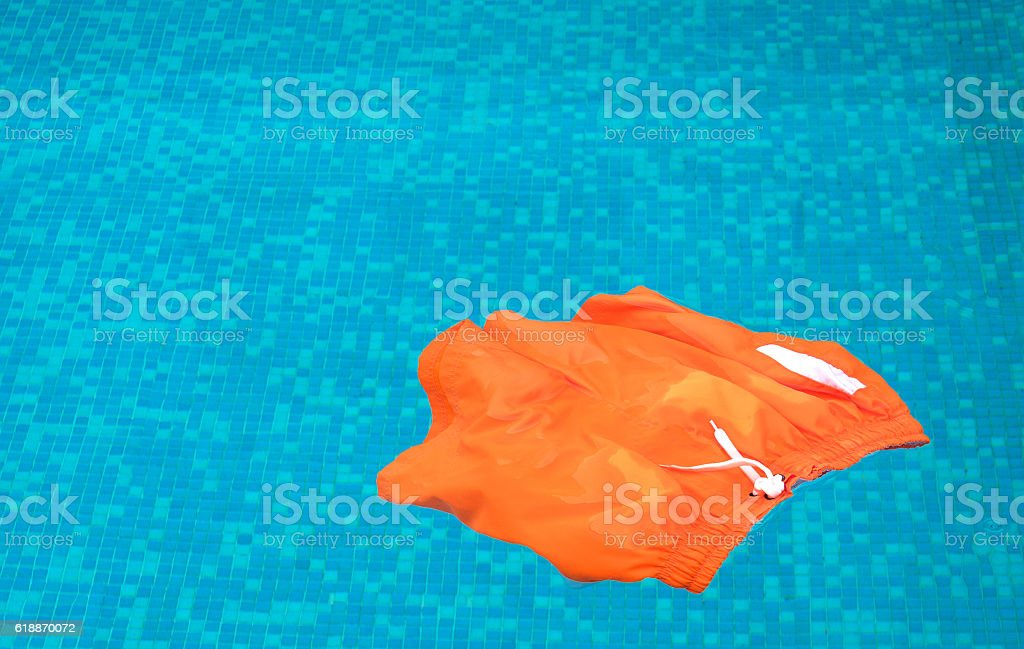 Swimming shorts floating in a pool stock photo