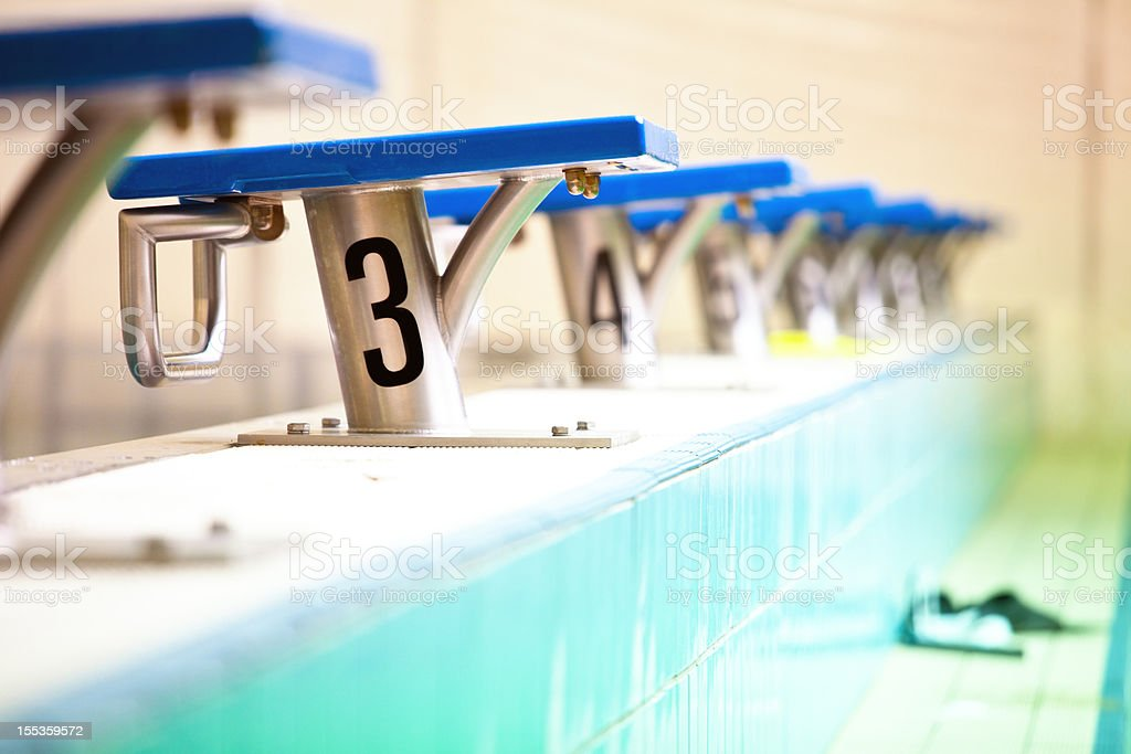 Swimming starting blocks stock photo