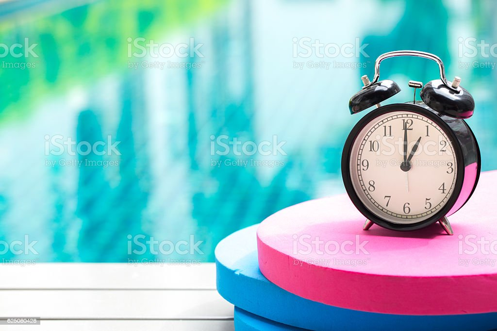 swimming times, clock time at 1 o'clock at swimming pool stock photo