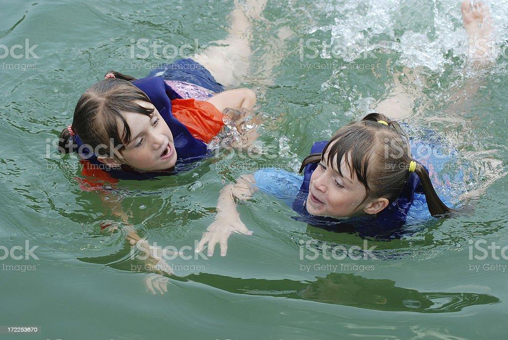 Swimming Twins royalty-free stock photo
