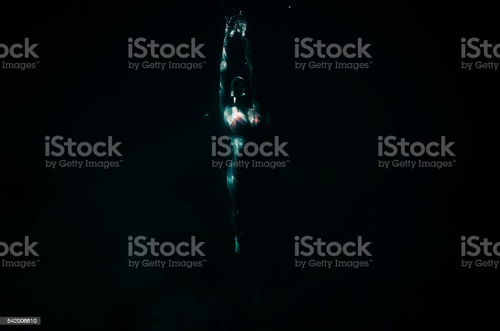 swimming up stock photo