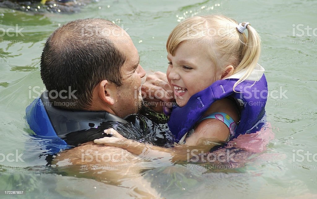 Swimming with Daddy in the Lake stock photo