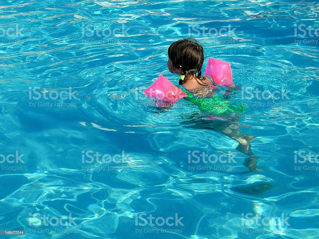 Swimming with floaties stock photo