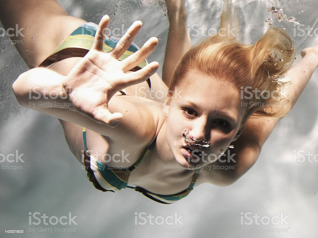 Swimming woman reaching out stock photo