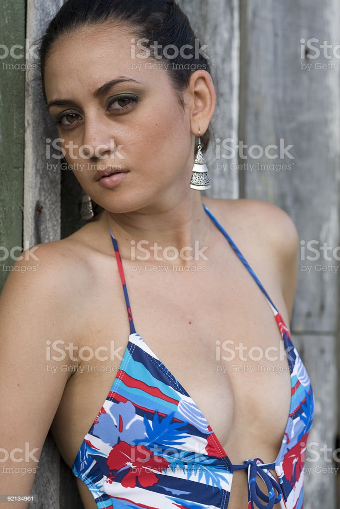 Swimsuit by wooden door. royalty-free stock photo