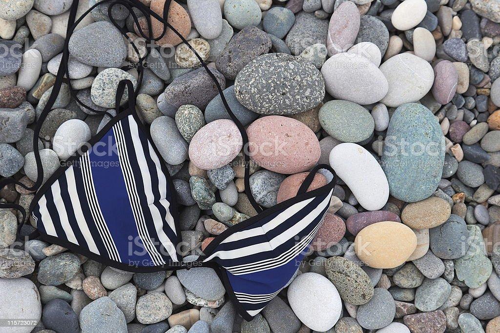 Swimsuit top on pebbles. Batumi. Georgia. royalty-free stock photo
