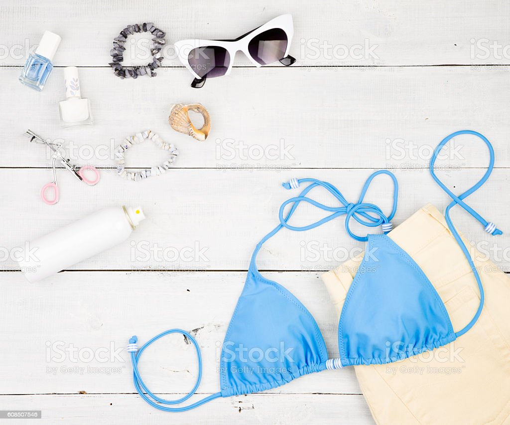 swimsuit, yellow shorts, cosmetics makeup, bijou and essentials stock photo