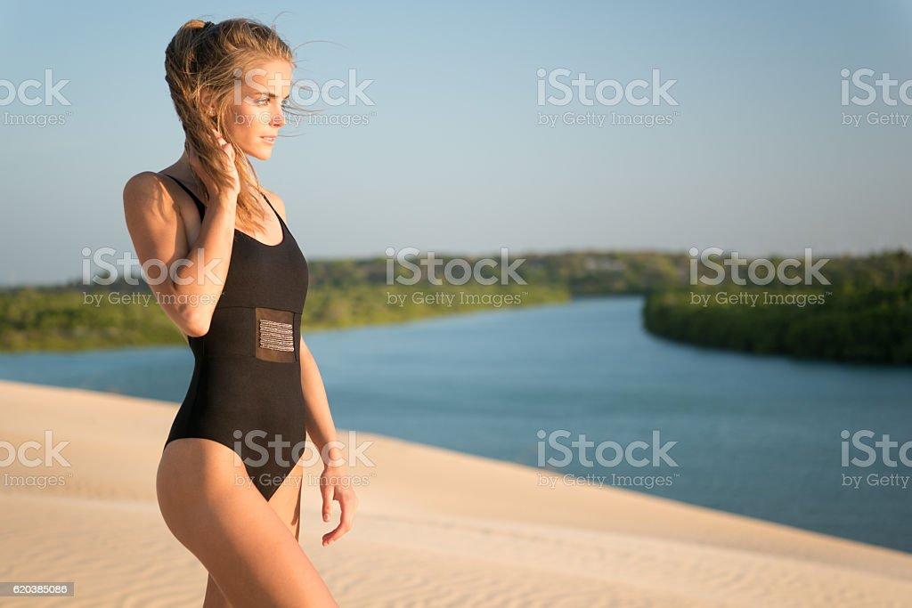 Swimwear Fashion Model watching the sun set stock photo