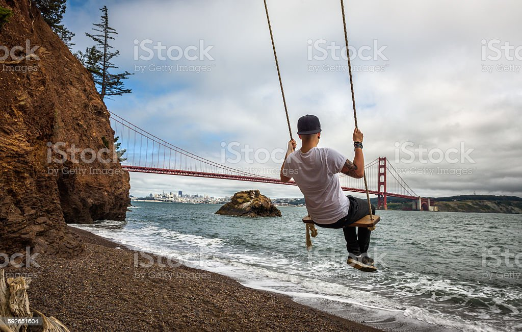 Swing and the Golden gate bridge stock photo