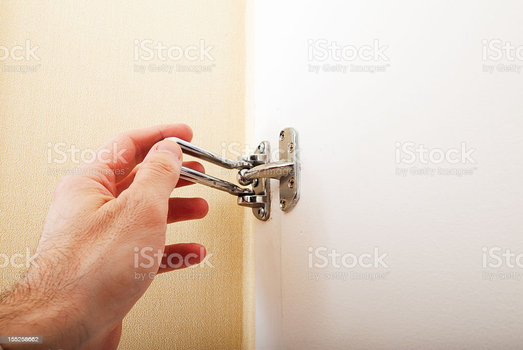swing arm security latch being closed in hotel room stock photo
