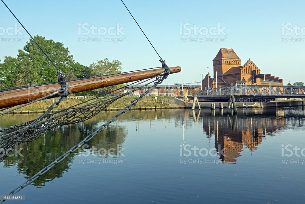 Swing bridge of Luebeck with bow of a sailing boat stock photo