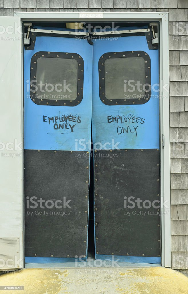 Swing doors with restriction stock photo