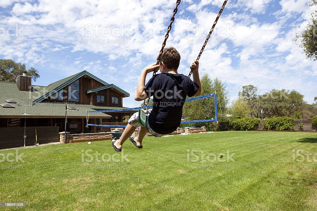 Swing in a backyard stock photo