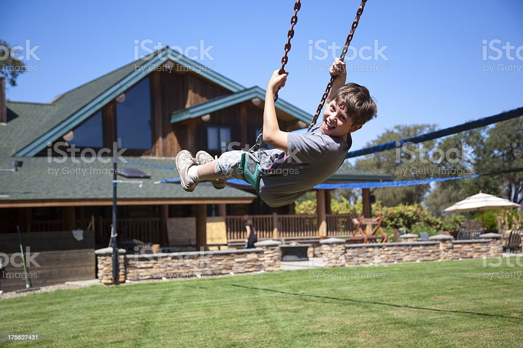 Swing in a front yard royalty-free stock photo