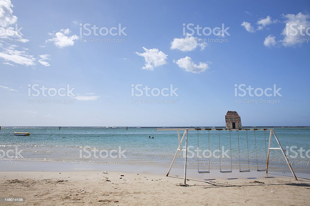 Swing on a beach royalty-free stock photo