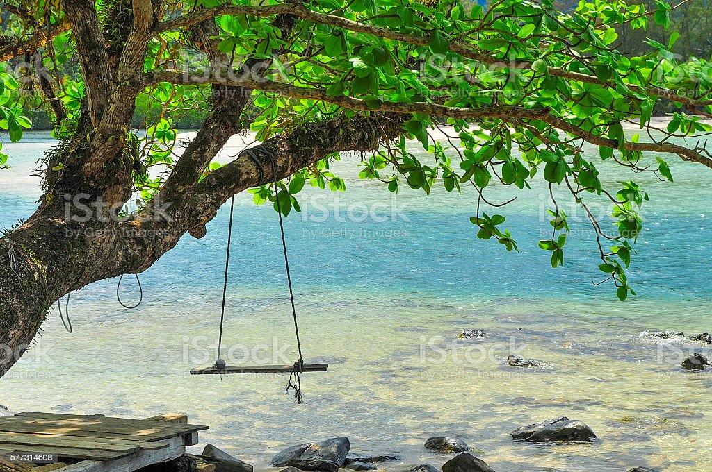 Swing on the beach at Kood Island Thailand stock photo