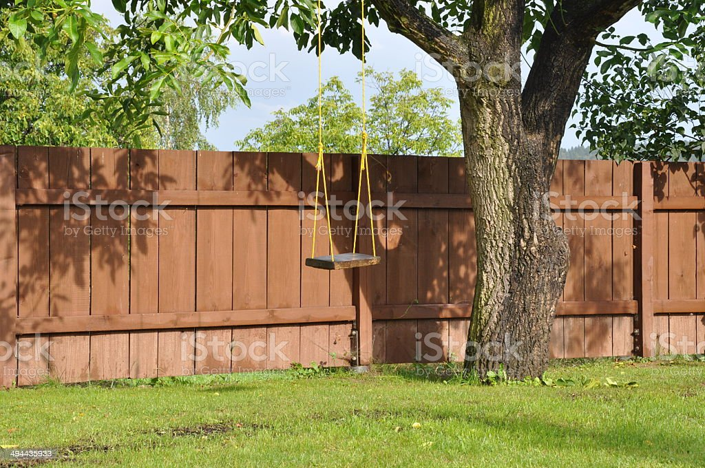 Swing on the tree in the garden royalty-free stock photo