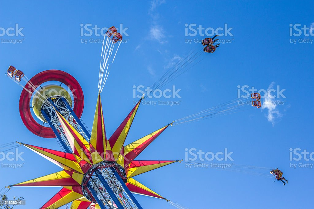 Swing seat exciting amusement ride stock photo