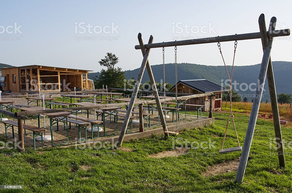 Swing Set and Barn Wooden sight platform in Vosges mountains stock photo