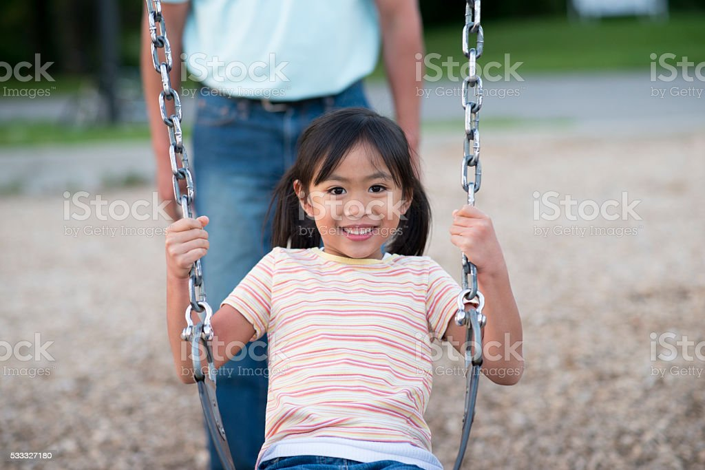 Swinging at the Park stock photo