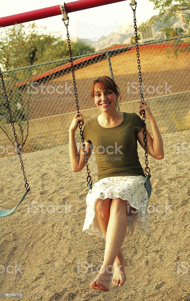 Swinging Cute Redhead royalty-free stock photo