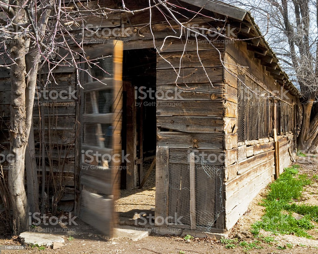 Swinging door on a farm house stock photo