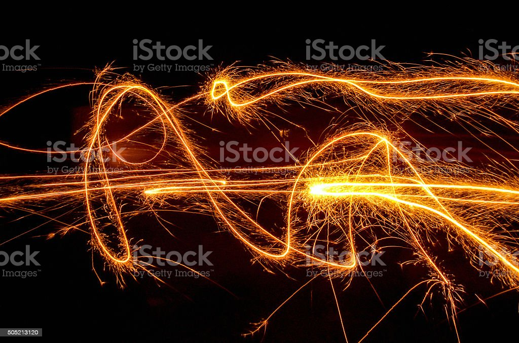swinging fireworks stock photo