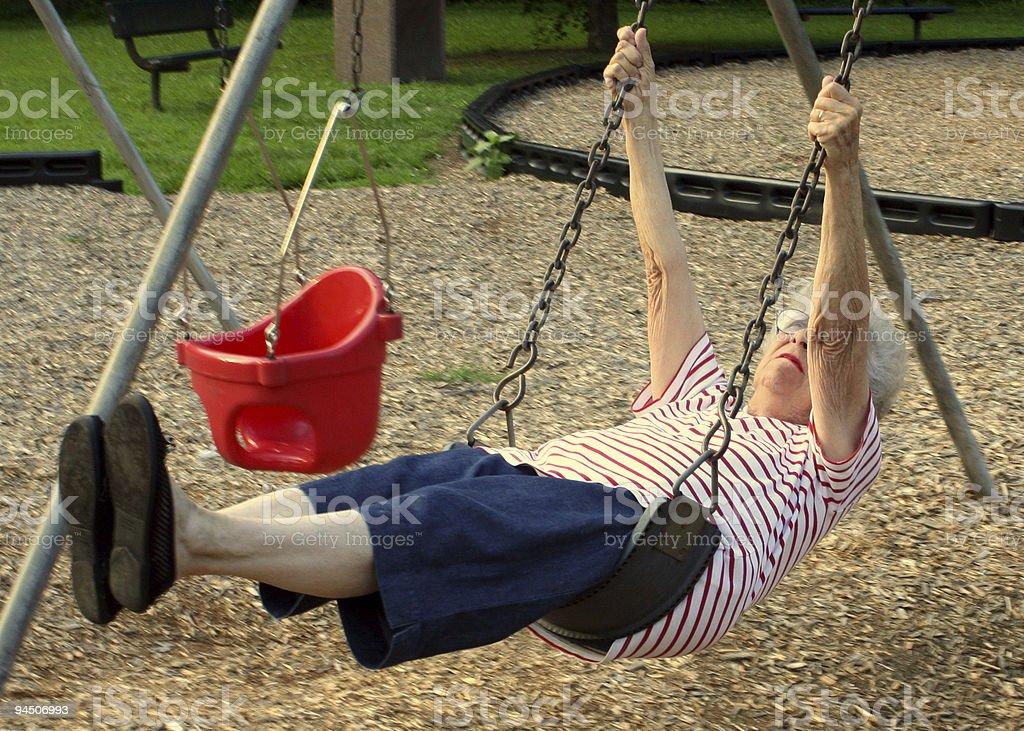 Swinging Grandmother 3 stock photo