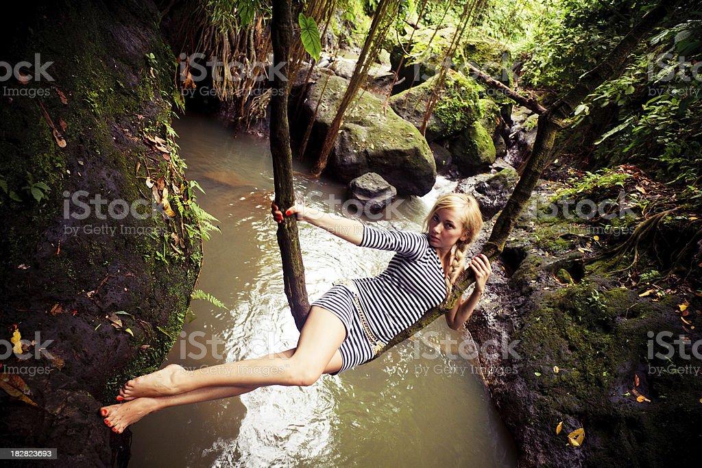 swinging on liana royalty-free stock photo