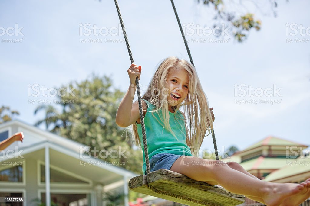 swinging up high stock photo
