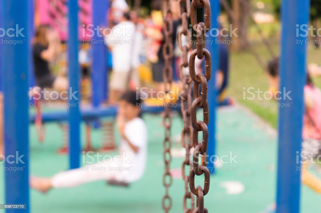 Swings at the playground in the park. stock photo